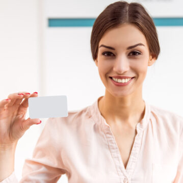 Portrait of a young woman who keeps the in the hands card of the patient
